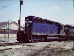 Blue Norfolk & Western SD40 1600 leads freight at Muncie - 1980