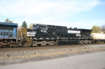 NS 9743 rounds out the consist, now onto freight cars