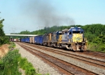 CSX 8010 leads Eastbound CSX Q640 MP126.4 on track number one.