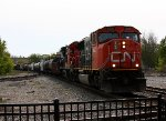 CN 5633 flies east with a freight