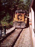 Eastbound Chessie freight in siding for NRHS excursion on Old Main Line - 1983