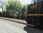 CSX 5334 leads a northbound general merchandise train past CSX 9999 Office Car Special