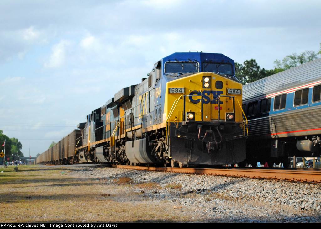 CSX 684 passes Amtrak P098