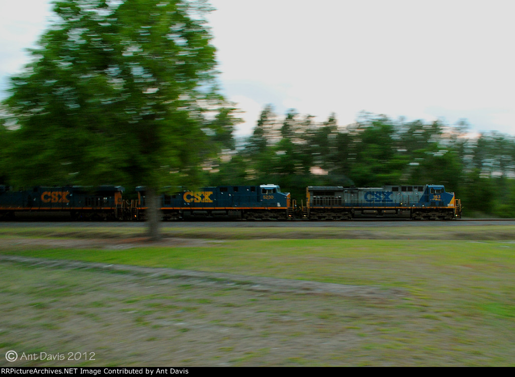 CSX 163 zooms past the Roadmaster's Lodge (In Color)