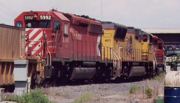 CP 5992 trailing on CP 166
