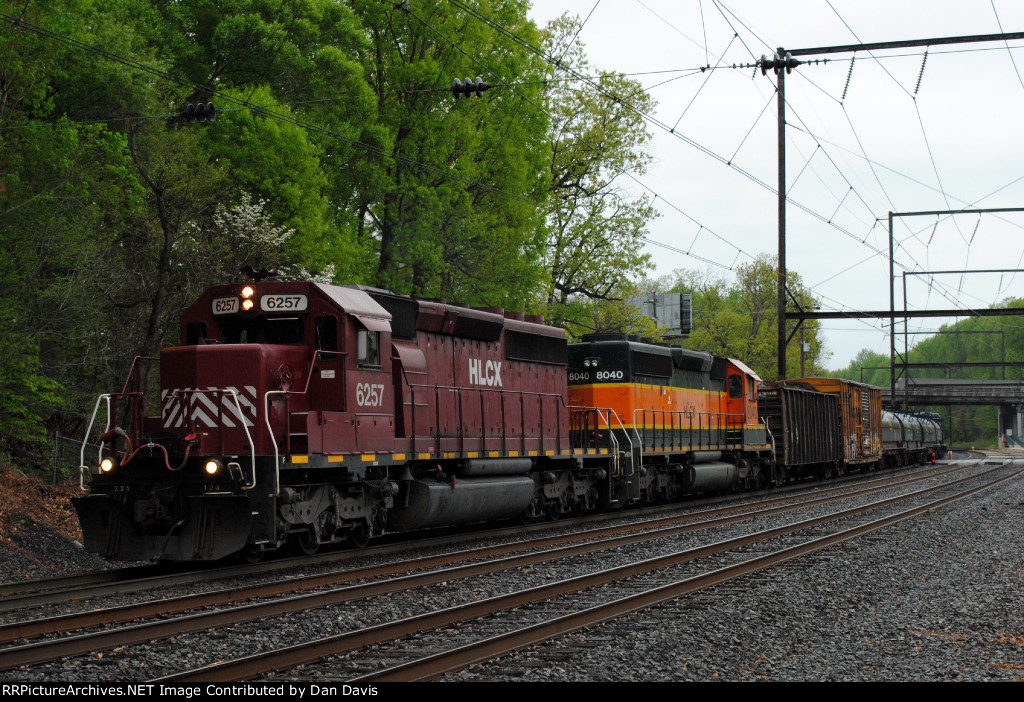 HLCX SD40-2 6257 in Red and White leads Q300-22