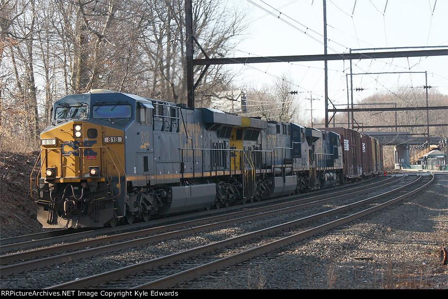 CSX ES44AC #818 leads Q438-16