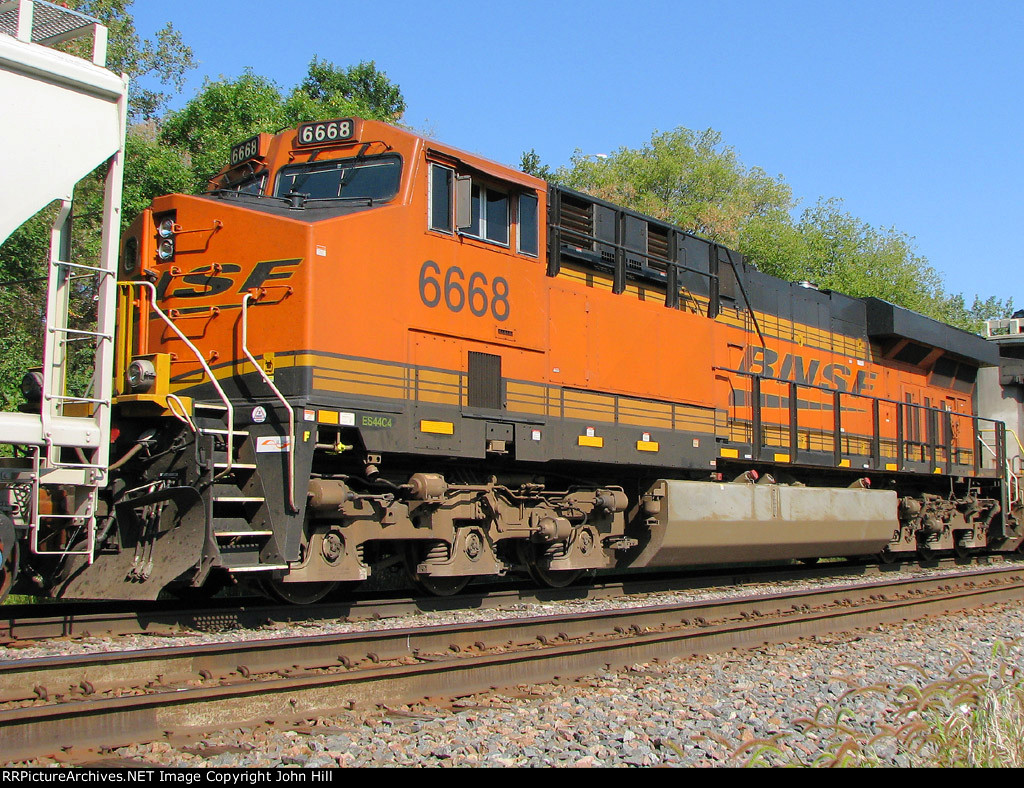120901012 BNSF 6668 On Eastbound Manifest Waiting In Siding