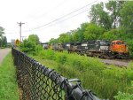 120718001 2 BNSF Eastbounds wait side by side at CTC East Wayzata Siding Switch