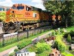 120820024 Westbound BNSF Grain Train Rolls Past Wayzata Depot And Nearby Garden Railway