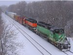 121229004 On a snowy day, eastbound BNSF 1846 & 1692 wait for a meet in the Wayzata passing siding