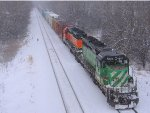 121229005 On a snowy day, eastbound BNSF 1846 & 1692 wait for a meet in the Wayzata passing siding