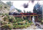 Mixed train crossing a trestle