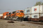 BNSF 6903 meets a wb stack train at the amtrak station.