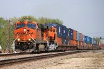 BNSF 7450 heads thur town with a stack train.