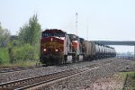 BNSF 783 takes a eastbound oil can train thur marceline.