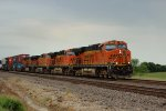 BNSF 7503 leads a wb stack under dark sky's.