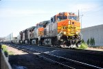 Eastbound intermodal pauses near crossovers