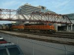 A BNSF stack train ducks under the Railfan Bridge in Kansas City