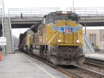 UP 8543 waits at the Bellwood Metra station for clearance to continue east