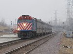 METX 160 rolls west with an outbound train