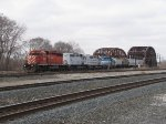 CP 6007 leads three lease units south on the IHB with CP's train 242