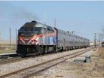 METX 415 heads away shoving an inbound train