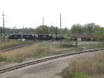 A trio of CSX GP15T's roll west over the diamonds with Y125
