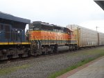 An Ex. BNSF SD40-2 trails a CSX Autorack Train