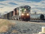 BN 9220 SD60M pulling coal drag through town