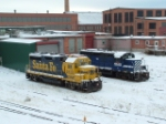 BNSF 2528 GP35U and MRL 112 GP9 sit outside the Talgo-LRC shops