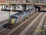 NS train 339 heads south in downtown B'ham. Look at the dude by the red truck. He was excited!