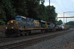 Q438-14 with CSX ES40DC 5235 leading the way