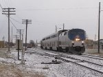 AMTK 22 brushes the dusting of snow off the railheads as P371 heads west