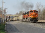 Working hard, BNSF 9135 & 9309 start pulling 130 coal loads east out of town