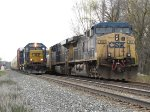 2354 leads D700-10 east past the parked Q326