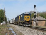 """D707-22 makes its way eastward past the old """"Tower"""" at the east end of the siding"""