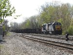 CSX 6465 leads D006 through Lamar as it heads for the High Line on the Odd Side