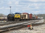 CSX 682 sits in 6 Track at the west end between two cuts of cars