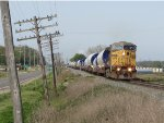 K242-28 rolls east with wind turbine towers in tow