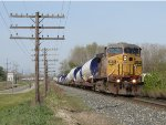 K242-28 heads east stretched out alongside the old codeline