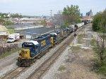 CSX 6116 leads D707-29 east past the Pleasant St signals