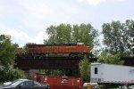 BNSF 8215 leads more grain loads from Gavilon at Avalon across the south Rock River bridge