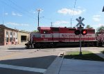 WSOR 3802 crosses Pearl Street while switching by the roundhouse