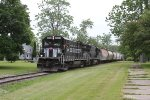 A pair of Finger Lakes B23-7's on GS2 pass East through downtown Seneca Falls.