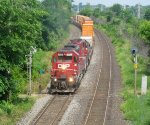CP 5790 & CP 5746 (both SD40-2s) head west through Beaconsfield, Qc.