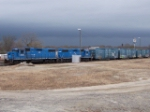 HLCX 3821 and 3819 on L&C with LC boxcars as storm clouds move in