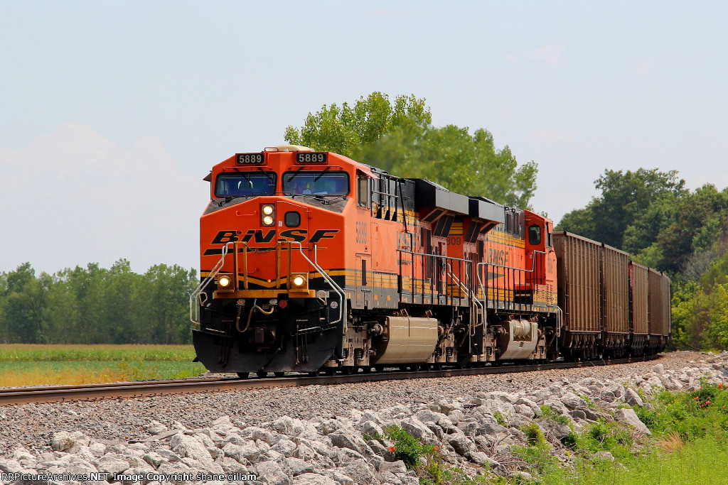 BNSF 5889 leads this empty coal nb.