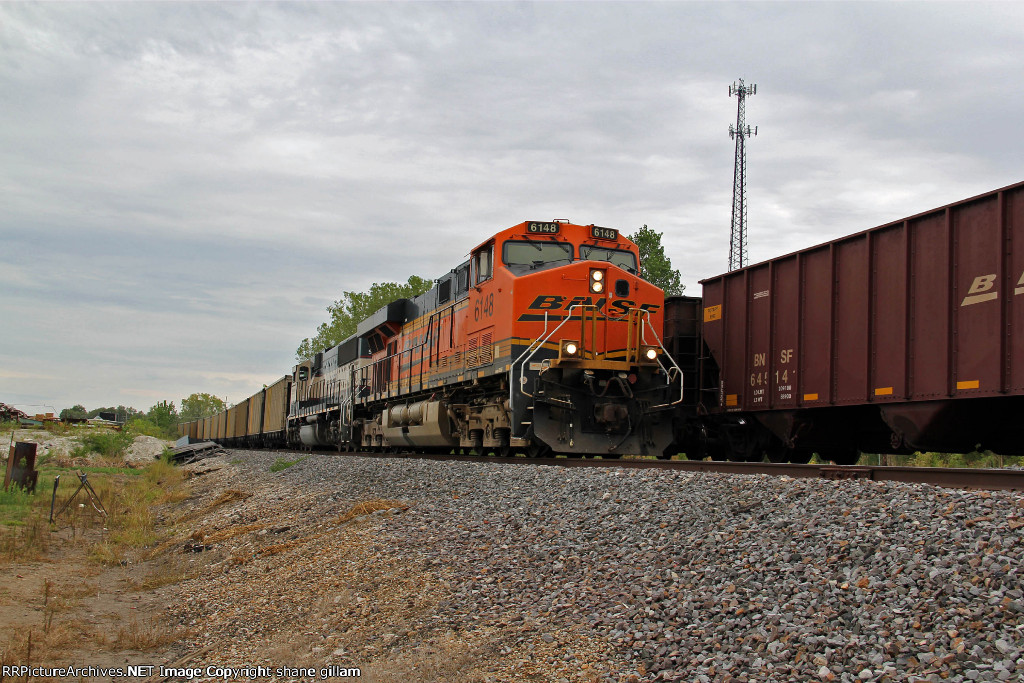 BNSF 6148 leads a empty ucex coal NB.