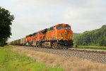 BNSF 5724 leads a empty coal back for more.